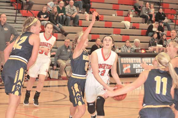 Houghton's Sloane Zenner, right, takes the ball to the basket against Negaunee's Clara Johnson Friday night. Zenner's 21 points paced a 48-46 Houghton win. (Houghton Daily Mining Gazette photo by Paul Peterson)