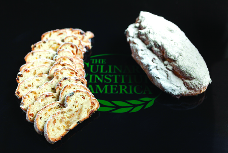 This Dec. 5, 2016 photo provided by The Culinary Institute of America shows a stollen in Hyde Park, N.Y. This dish is from a recipe by the CIA. (Phil Mansfield/The Culinary Institute of America via AP)