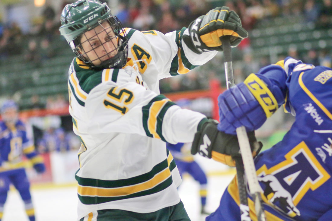oakley hockey zewo  top, defends Westwood's Nathan Beckman as he looks to pass the ball on  Tuesday night at Gwinn High School Journal photo by Rachel Oakley