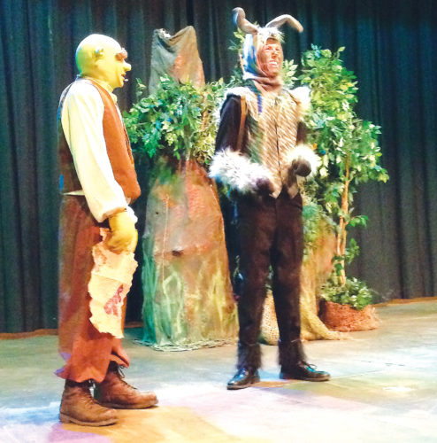 "Submitted Photo Shrek, performed by Miles Anderson, shares the stage with Donkey, played by Hunter Benjamin. ""SHREK! The Musical"" will open tonight at Minot High School-Magic City Campus."