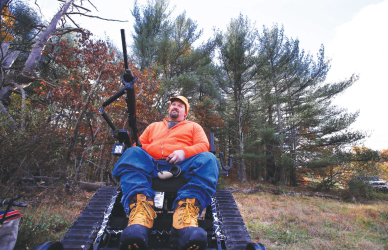 AP Photo  Paraplegic hunter Gary Dupuis, Ashburnham, Mass., waits in his all-terrain wheelchair, equipped with a shooting rack for his shotgun, while deer hunting in Devens, Mass.