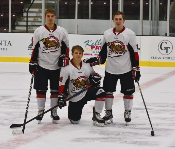 Garrick Hodge/MDN From left: Kyle Lipinski, Bryce Lipinski and Lyndon Lipinski pose for a photo at center ice at the Pepsi Rink of Maysa Arena in Minot.