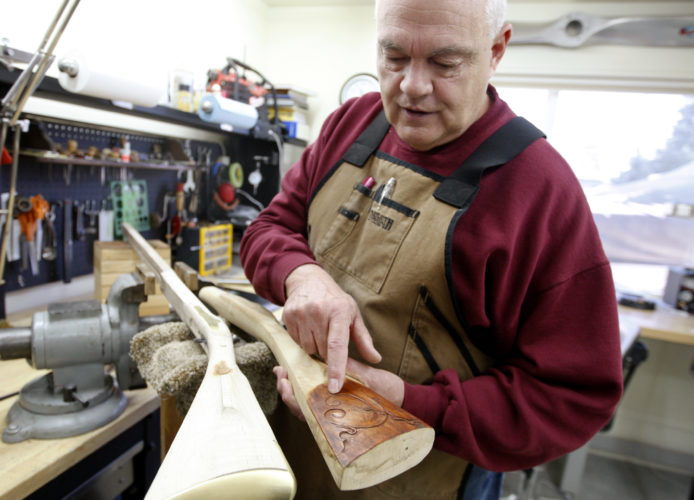In a Nov. 22, 2016 photo, Jim Bonawitz talks about his historic replica flintlock rifles in his workshop in Billings, Mont. (Casey Page/The Billings Gazette via AP)