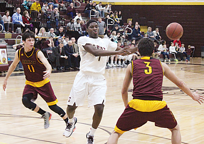 MDN file photo Magi guard KyJuan Johnson makes a no-look pass against Turtle Mountain Community High School in a conference game played last season at Minot High School.