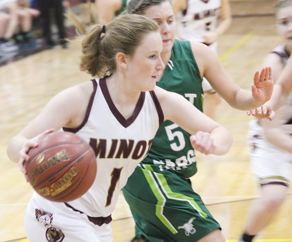Alex Eisen/MDN Majettes senior guard Taylor Benno drives to the basket against West Fargo on Friday in the season-opener for the Minot High girls basketball team.