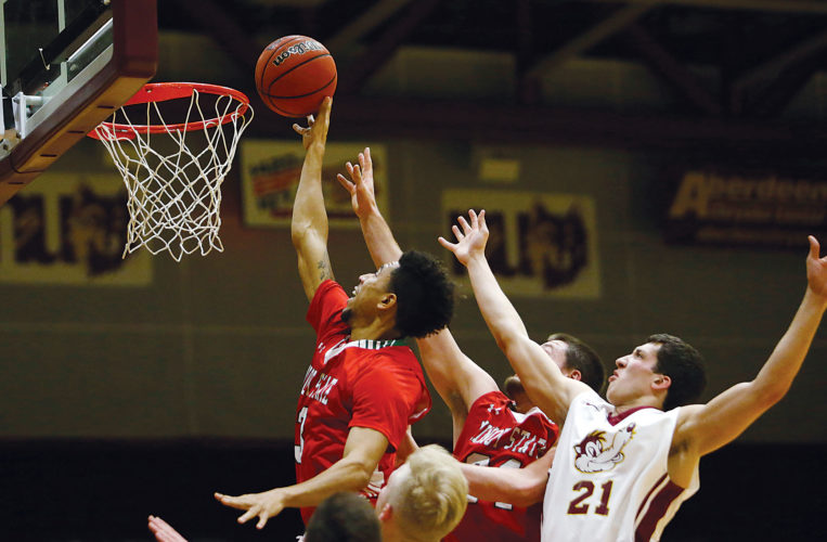 Photo courtesy of John Davis/Aberdeen News  Minot State's Brandon Green (3) tips in a shot during a men's college basketball game on Friday in Aberdeen. Northern State beat Minot State 91-87.