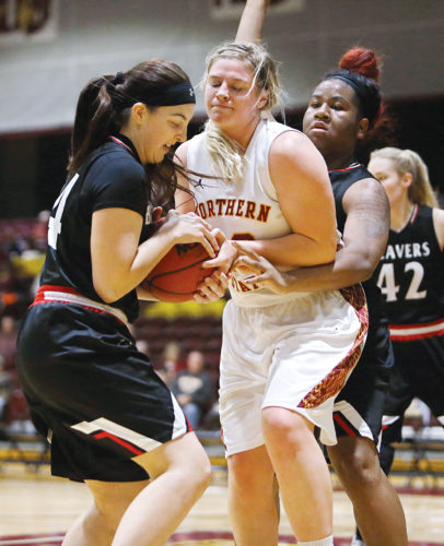 Photo courtesy of John Davis/Aberdeen News  Minot State's Shyla Carr (24) and Kristal Flowers (40) try to steal the ball from Northern State's Jill Conrad (40) during a women's college basketball game on Friday in Aberdeen.
