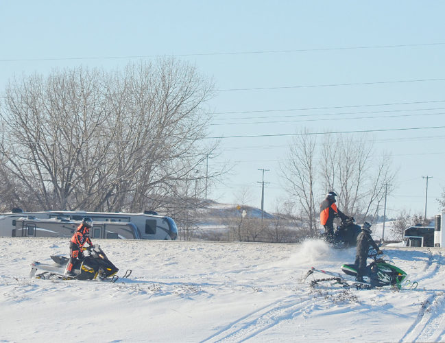 This past week's snowstorm brought good conditions for winter-type activities including these snowmobilers enjoying Sunday on Minot's snow-covered hills. The National Weather Service forecasts a chance of snow at times and much colder temperatures during the week.  Eloise Ogden/MDN
