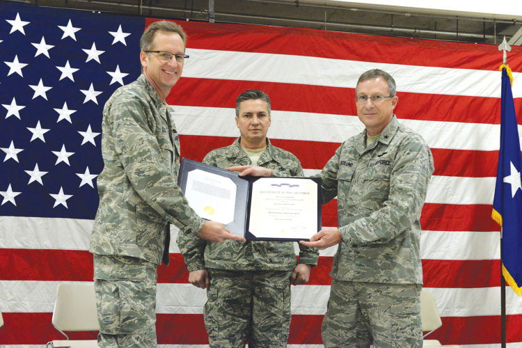 Submitted Photo From left to right U.S. Air Force Col. Kent Olson, the 119th Wing commander, Chief Master Sgt. Duane Kangas, the 119th Wing command chief, and Brig. Gen. Robert Becklund, the North Dakota deputy adjutant general, hold the Air Force Outstanding Unit certificate during a ceremony at the North Dakota Air National Guard Base, Fargo, Saturday, shown in this photo by Senior Master Sgt. David H. Lipp.