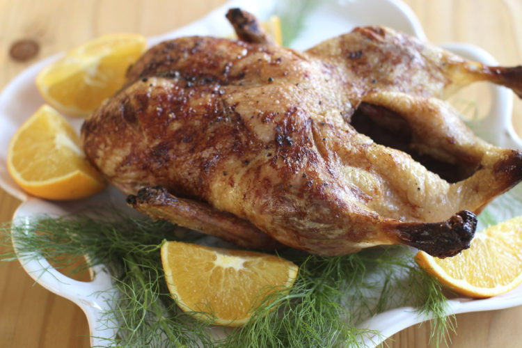 FILE - This Oct. 26, 2015, file photo, shows bistro style slow roasted duck in Concord, N.H. Roasting a duck is no more complicated than roasting a turkey, and this recipe also has a French-style sauce. (AP Photo/Matthew Mead, File)