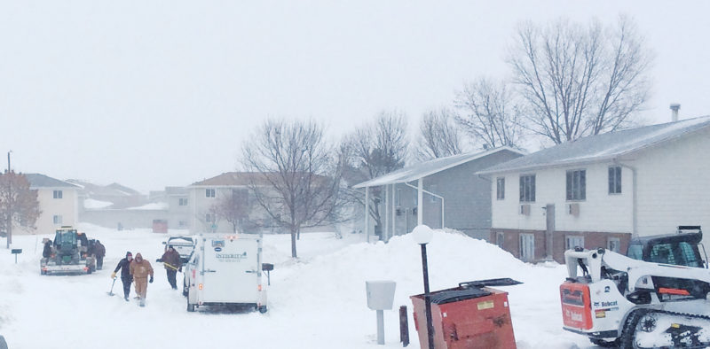 Andrea Johnson/MDN City road crews and private companies have worked through the week to remove snow, but colder weather is ahead for Minot.
