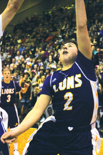 MDN/File photo Bishop Ryan's Eli Stewart goes up for a shot during a game last season.