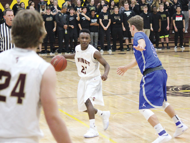 Alex Eisen/MDN Senior guard Trevor Banks surveys the floor for Minot High in the Magi's conference-opener against St. Mary's on Saturday in Minot.