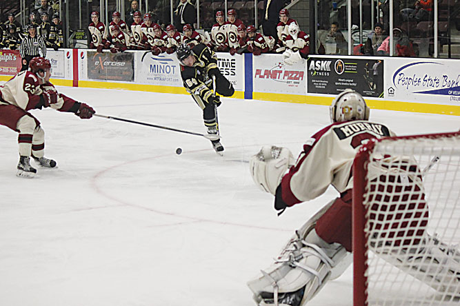 Alex Eisen/MDN Bismarck forward Nick Alexander (64) unleashes a shot at Minotauros goaltender Lucas Murray Friday night in a North American Hockey League game played at Maysa Arena in Minot.