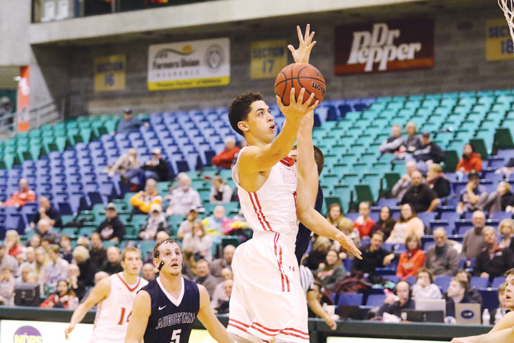 Photo courtesy of Sean Arbaut/Minot State athletics  Minot State's Nathaniel Moore goes for a basket during a men's college basketball game Friday.