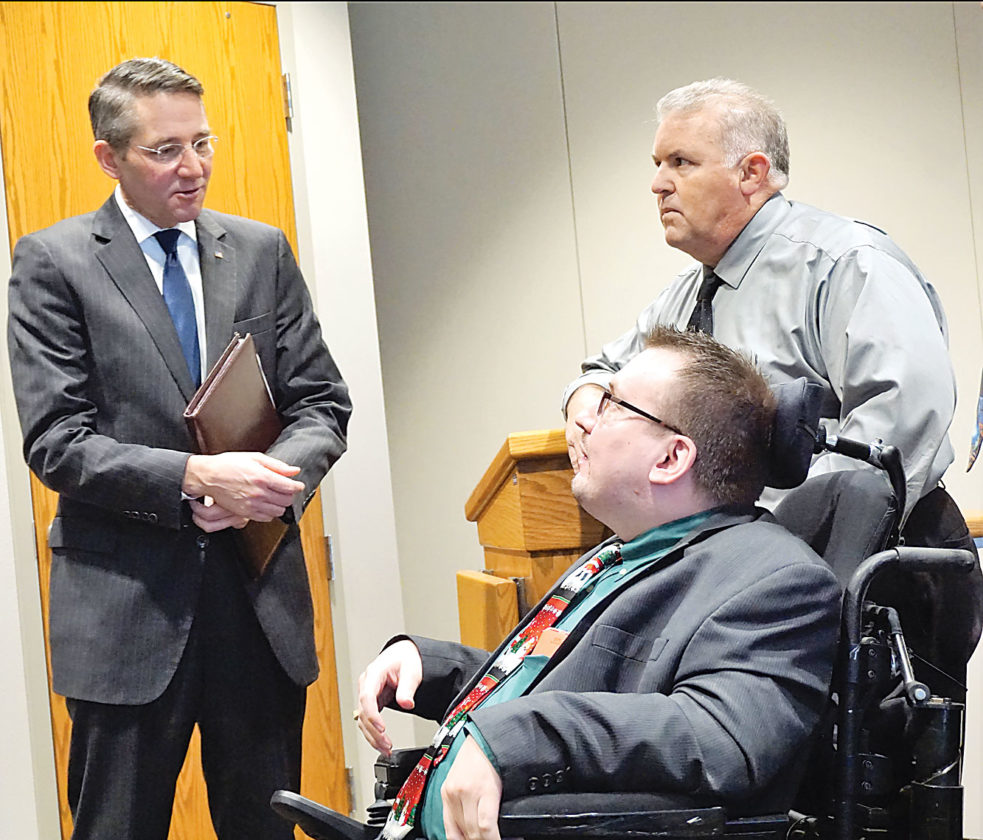 AP Photo Lt. Gov. Drew Wrigley, left, talks with attorney Brandon Rowenhorst, 2017 president of the Ward County Bar Association, and District Judge Richard Hagar after a bar association meeting in Minot Friday.