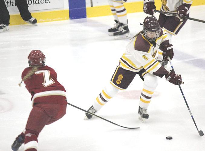 Alex Eisen/MDN Majettes eight grader Paige Ackerman (9) skates through center ice against Fargo Davies on Saturday at Maysa Arena in Minot.