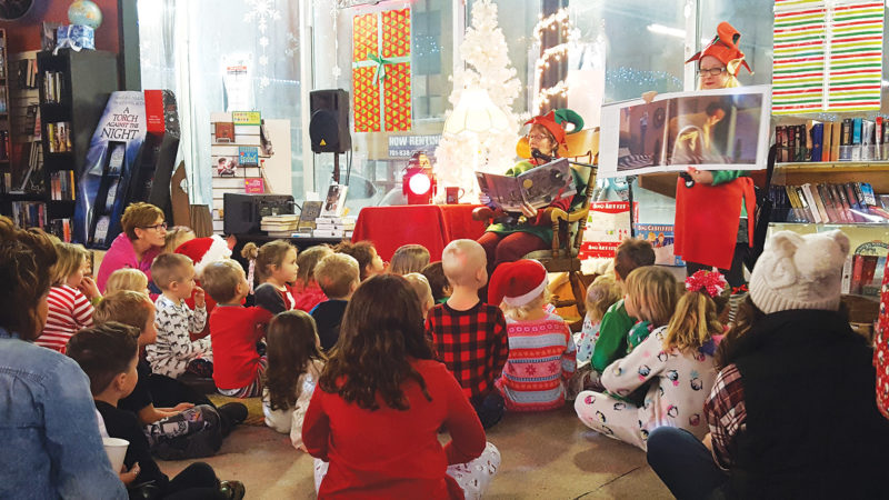 """SubmittedPhoto  Families listen to Danielle Sweeney as she reads """"The Polar Express"""" Tuesday evening at Main Street Books."""