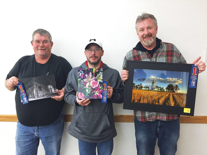 Submitted photo Tim Zeltinger, left, Cory Hansen and Erich Linser are recipients of the Minot Camera Club annual People's Choice Award.