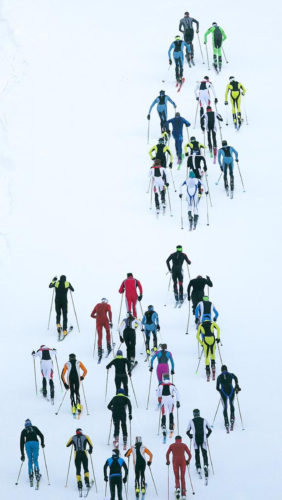 Ski mountaineering racers make their way up the 45th Parallel run during the Northwest Passage Ski Mountaineering Vertical Race at Brundage Ski resort in McCall, Idaho. The vertical race featured a sprint to the top of the mountain that included 530 meters of elevation gain. (Kyle Green/Idaho Statesman via AP)