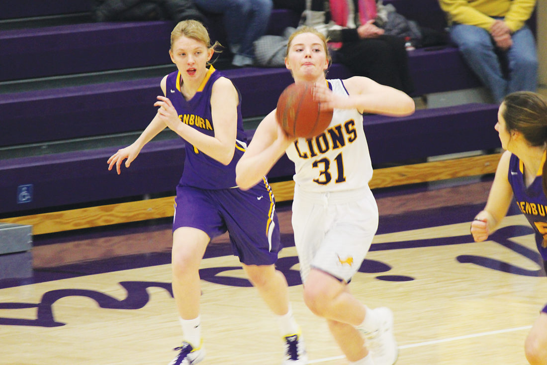 Alex Eisen/MDN Ryan junior McKinlee Harmon (31) passes the ball up the court on a Lions' fast break against Glenburn in a Region 6 contest played Monday.