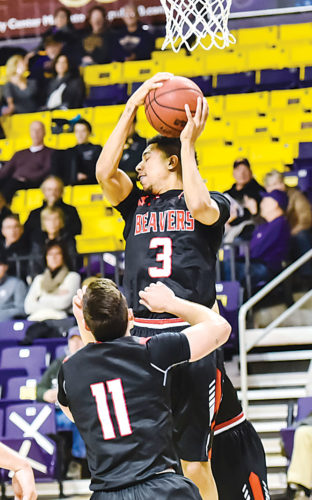 Levi Janssen/The Mankato Free Press Minot State's Brandon Green (3) pulls down a rebound during an NSIC men's college basketball game on Friday in Mankato, Minn.