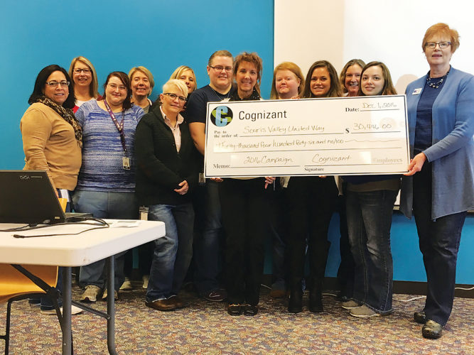 Submitted Photo Cognizant recently presented a check to Patricia Smith and Danielle Rued from the Souris Valley United Way at their Minot location.  Employees and vendors raised $15,223.00 which Corporate Cognizant matched for a total donation of $30,446.  Fundraising events were held all year with the biggest push during October's Employee Giving Campaign. Heidi Llewellyn and Cara Olson co-chaired the campaign. Events held included: Pay to Dress Down, loose coin drive, silent auction that included reserved parking spaces, taco in a bag, bake sales, soup & chili cook off and sale, donut sale, purse drive and sale, 50/50 raffle, Pie in the Eye event, and Halloween costume contests. Many of these events included a friendly team competition. In addition, local vendors involved with the clothing sale and the book fair made donations on behalf of Cognizant.