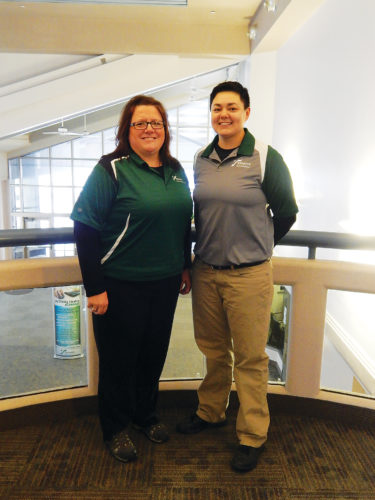"Submitted Photo Robyn Gust, left, Trinity Health Sports Medicine Manager, received the ""Patriot Award"" from the Employer Support of the Guard and Reserves. Gust was nominated by Ashley King, right, an athletic trainer with Trinity Health and member of the North Dakota National Guard."