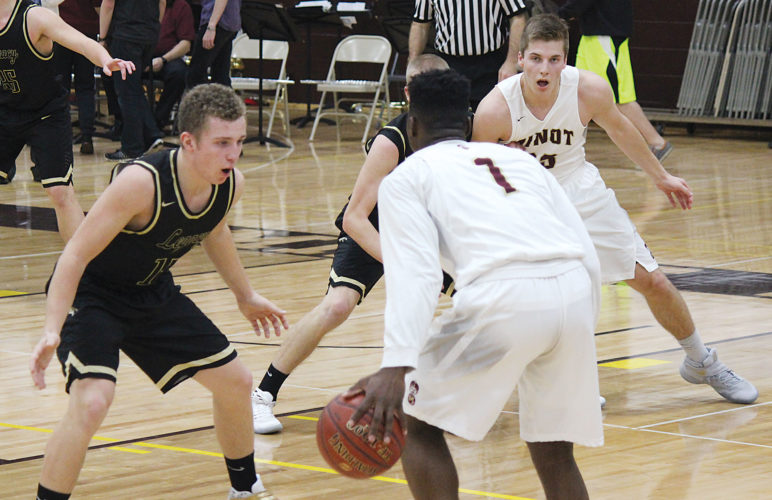 Alex Eisen/MDN Minot High senior Justin Engg posts up his Legacy defender while senior guard KyJuan Johnson (1) holds the ball in a West Region game played Tuesday night at Minot High School.