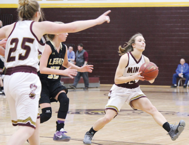 Alex Eisen/MDN Majettes guard Alli McCoy (14) passes the ball Tuesday evening in a West Region game against Bismarck Legacy at Minot High School.