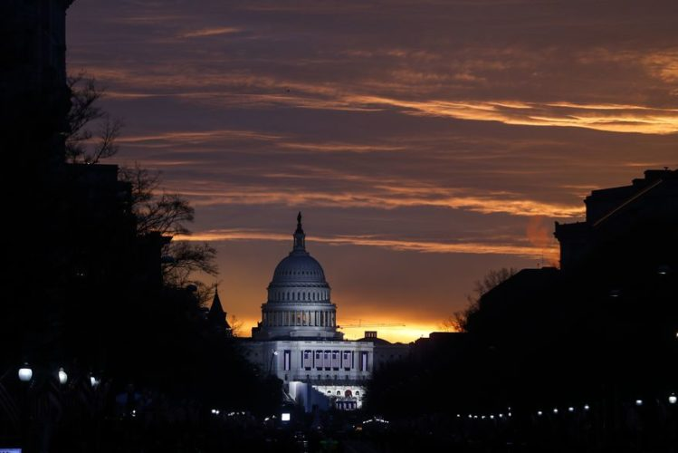 AP Photo The Capitol Building is illuminated against the sunrise before the presidential inauguration of President--elect Donald Trump in Washington, D.C., today.