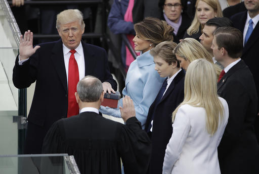 Donald Trump is sworn in as the 45th president of the United States by Chief Justice John Roberts as Melania Trump looks on during the Presidential Inauguration at the U.S. Capitol in Washington, Friday, Jan. 20, 2017. (AP Photo/Matt Rourke)
