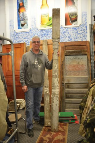 Eloise Ogden/MDN  Repurposing and shabby chic are current trends. Dale Ganske, owner of Central Avenue Variety in Minot, holds an old pillar that might be repurposed or made into a new treasure.