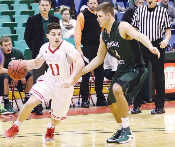 Minot State's Luis Ricci Maia (11) dribbles the ball during a men's college basketball game Friday at the MSU Dome in Minot.
