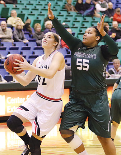 Photo courtesy of Sean Arbaut/Minot State athletics  Minot State freshman forward Reina Strand (42) drives to the lane during a women's college basketball game Friday at the MSU Dome in Minot.