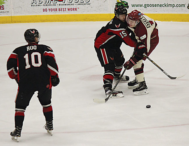 Alex Eisen/MDN Minotauros forward Reid Stefanson (14) gets tangled up with Aberdeen Wings defender Keenan Spillum (15) while trying to take a shot in the first period of NAHL game played Friday night at Maysa Arena.