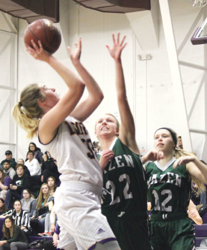 Alex Eisen/MDN Ryan senior Morgan Kroeger (33) attacks the basket in a Class B basketball game against Hazen on Saturday evening at Bishop Ryan High School. The Lions won 59-49.