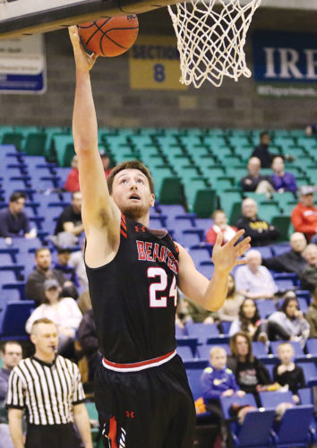 Photos courtesy of Sean Arbaut/Minot State athletics  Minot State forward Tyler Rudolph (24) converts a layup during a men's college basketball game Saturday at the MSU Dome.