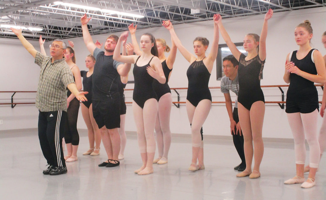 """Allan Blanks/MDN Choreographer and instructor Rinat Mouzafarov, gives a demonstration to students in preparation for their performance in """"Fiddler on the Roof""""."""