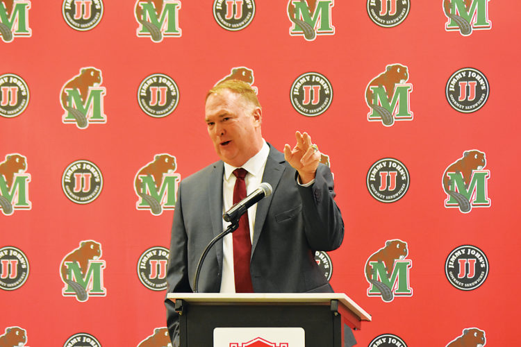 Garrick Hodge/MDN Minot State football coach applicant Jerry Partridge speaks to community members during an on-campus interview Monday at Minot State University.