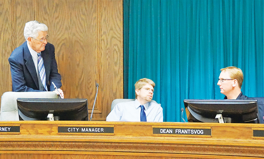 Jill Schramm/MDN Bob Schempp with the Northwest Area Water Supply project advisory committee, Minot City Manager Tom Barry and Dean Frantsvog, council member, talk further at the close of a sales tax ad hoc committee Monday in City Hall.
