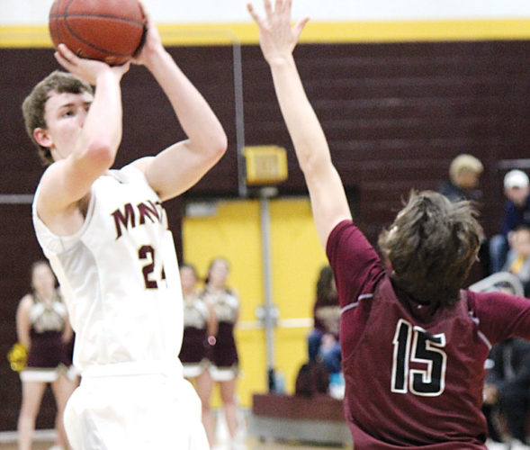 Alex Eisen/MDN Minot High junior Peyton Lamoureux (24) rises up for a 3-pointer against Bismarck High in a West Region game played Jan. 7 at Minot High School.