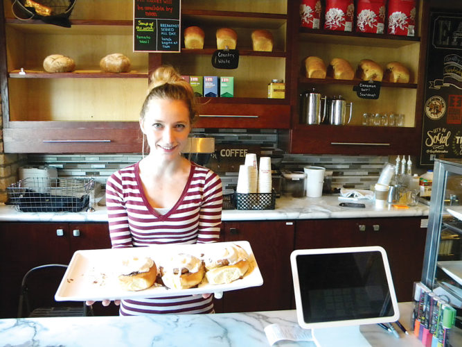 Kent Olson/MDN Emmily Nelson with some of the homemade pastries she and her husband, Jeffery, serve up at The Bread Box.