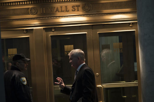 FILE - In this Tuesday, Oct. 25, 2016, file photo, a trader speaks to a security guard as he leaves the New York Stock Exchange, in lower Manhattan. European shares rose solidly Tuesday, Feb. 7, 2017, after a leading American investment firm recommended clients to buy the region's stocks. (AP Photo/Mary Altaffer, File)