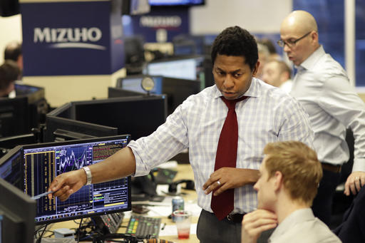 In this Jan. 12, photo, traders work on the Mizuho Americas trading floor in New York. Stocks are opening slightly lower on Wall Street, Wednesday, Feb. 8, 2017, a day after the Nasdaq composite notched another record high. (AP Photo/Mark Lennihan)