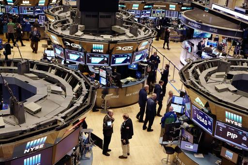 Traders work the floor Feb. 9 at the New York Stock Exchange. (AP Photo/Mark Lennihan)
