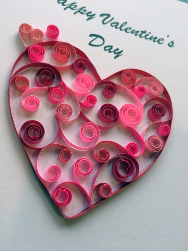 In this image provided by Kari Cronbaugh-Auld of Olathe, Kan., open coil scrolls in various shades of red and pink combine to create a heart shaped message. Quilling, which involves rolling thin strips of paper into various coil shapes and many other techniques, adds extra elegance to a Valentine's Day greeting.(Kari Cronbaugh-Auld/Quillique via AP)
