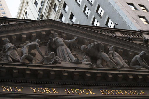 This Tuesday, Oct. 25, 2016, file photo shows the New York Stock Exchange at sunset, in lower Manhattan.  U.S. stock indexes extended their climb into record heights early Friday, Feb. 10, 2017,  powered by rising energy prices.  (AP Photo/Mary Altaffer, File)