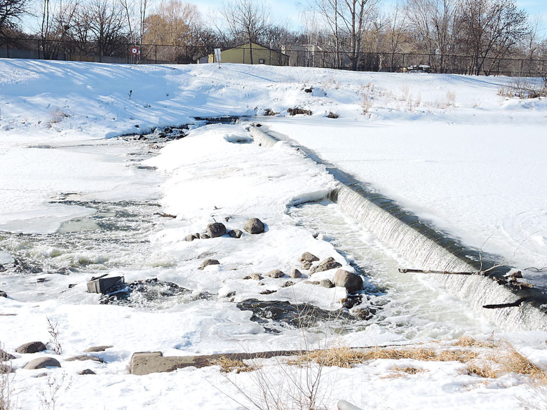 Kim Fundingsland/MDN Water flows in the Souris River, the result of water being released from Lake Darling Dam. Warm temperatures and increased releases are expected to erode ice on the river in the coming days.