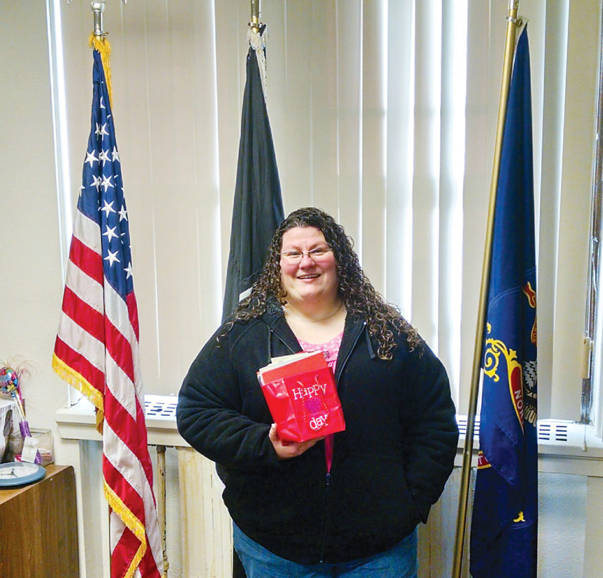 Submitted Photo Valentine's Day cards from Minot American Legion Women's Auxiliary Unit No. 26 were delivered to veterans attending Minot State University. Alicia Ramon, president of Unit No. 26, is shown in the photo.